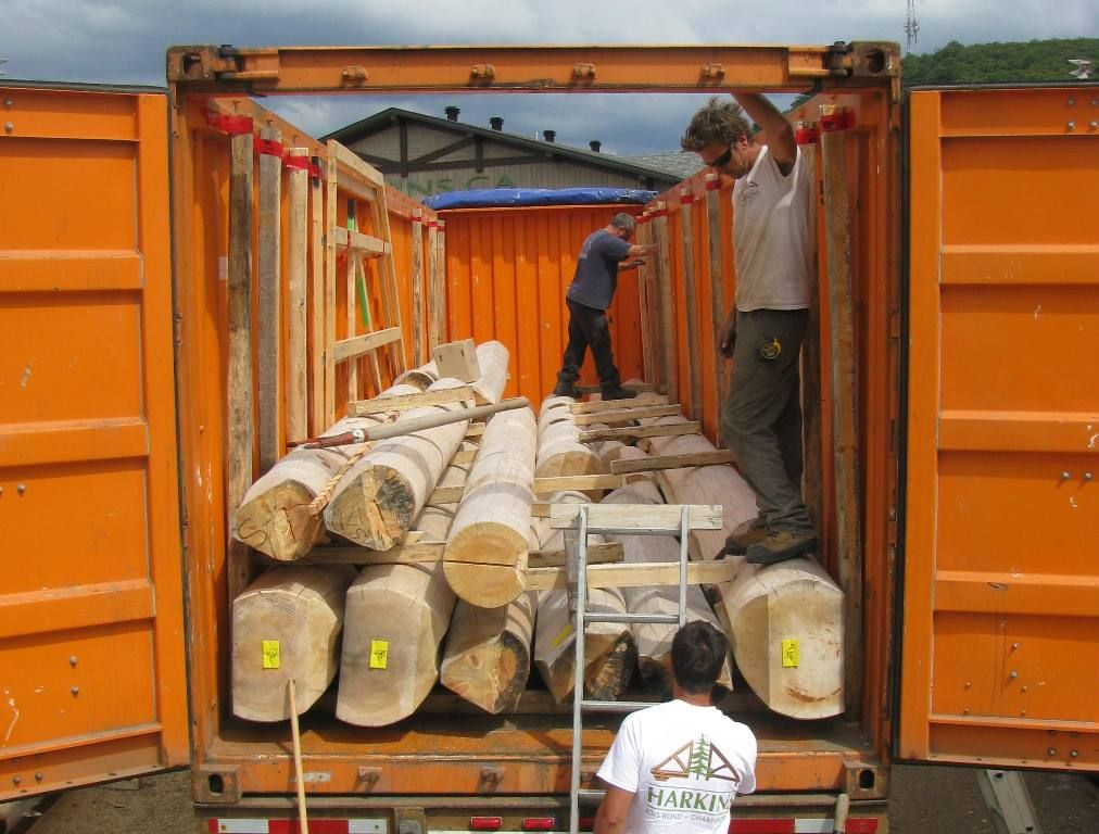 log houses packaging into containers going to morroco