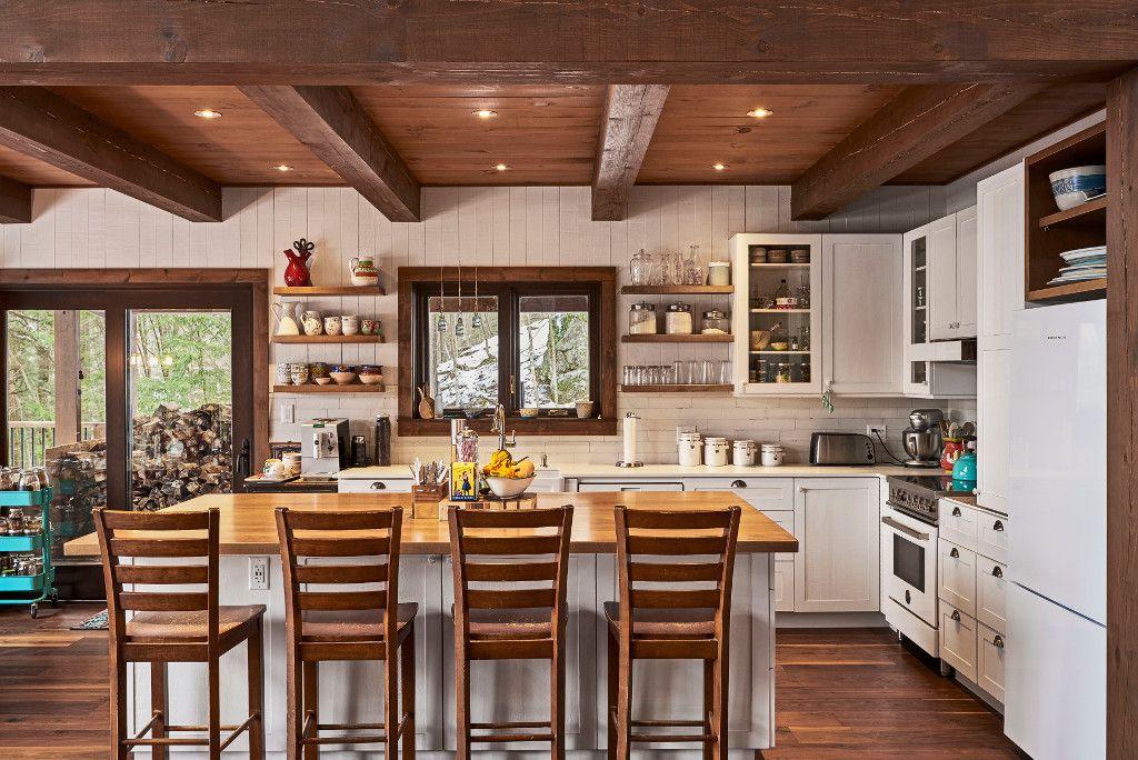 R alisations de bois rond charpenterie et autres projets for Maison bois massif